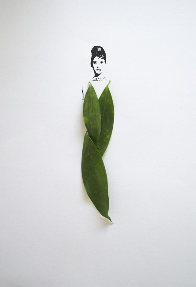 緑色の葉のドレスを着た女性のイラスト